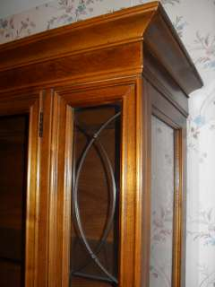 China cabinet   2 piece cabinet with glass shelves and lights