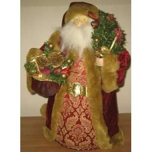 Santa Claus Holding Christmas Tree Figurine