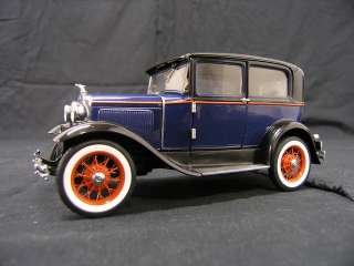 This is a 1930 Ford Model A Tudor by Franklin Mint 124 Scale. For