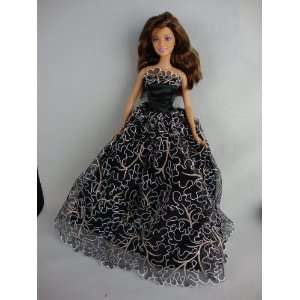 Black Ball Gown with White Lace and Gold Details Made to